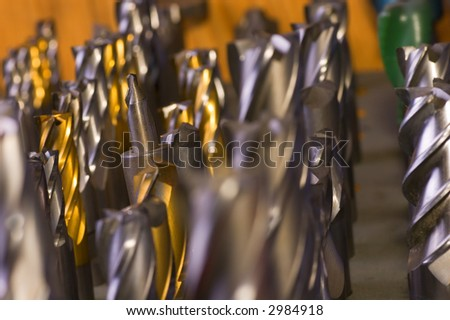 Drill bits and endmills placed down on a table
