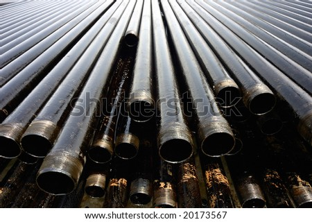 Drill pipes with oil drops - stock photo