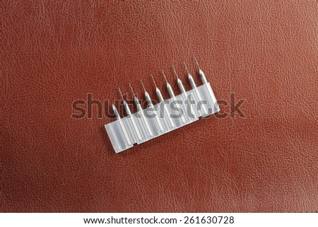 Drill spare part in the plastic containing box represent the repairing tool equipment material concept idea related. - stock photo