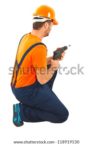 Driller man working with a drill isolated on white background - stock photo