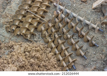 drilling augers after dirt drill,  used to drilling under street for sewer pipes - stock photo