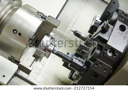 drilling hole or boring detail on metal cutting machine tool at manufacturing factory - stock photo