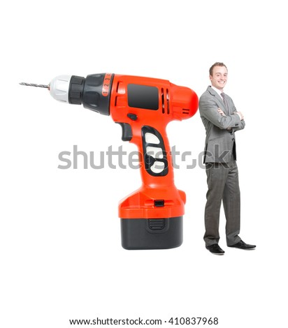 Drilling machine and businessman on white - stock photo