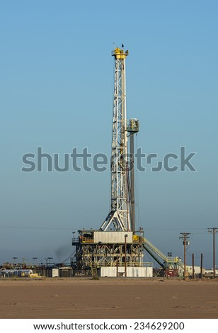 drilling rig set up in the desert - stock photo