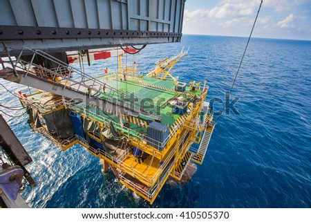 Drilling rig working on oil and gas wellhead platform - stock photo