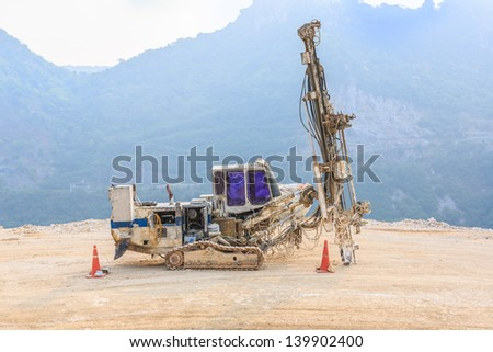 drilling ring drill parking at mine site - stock photo