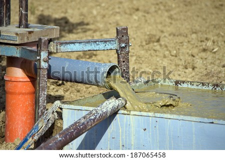 Drilling water bore on the agricultural field for irrigation purposes.  - stock photo