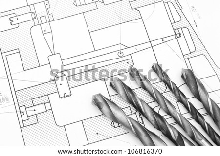 Drills on the drawing . - stock photo