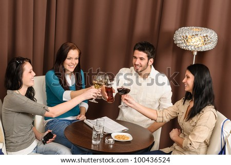 Drink after work happy friends toasting at bar have fun - stock photo