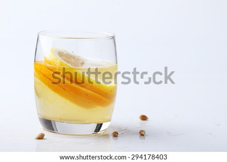 drink and stack of citrus fruits slices. Oranges and lemons. On white background