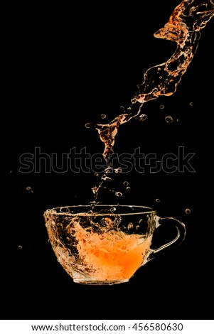Drink cocktail glass splash out on a black background.