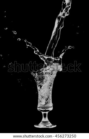 Drink Cocktail splash of  glass on a black background.