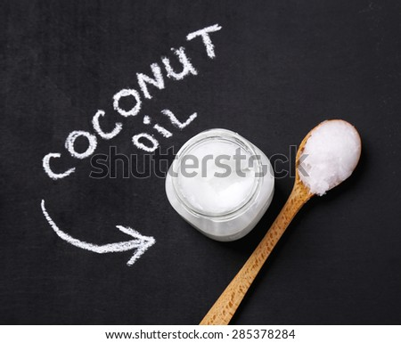 Drink. Coconut oil on the table - stock photo