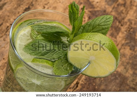 drink decorated with lime and mint leaves - stock photo