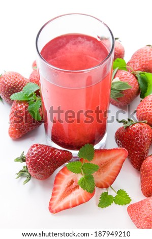 Drink from fresh berries of strawberry. - stock photo