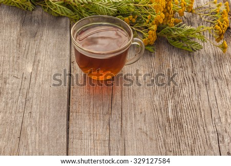 Drink from tansy as the concept of traditional medicine - stock photo