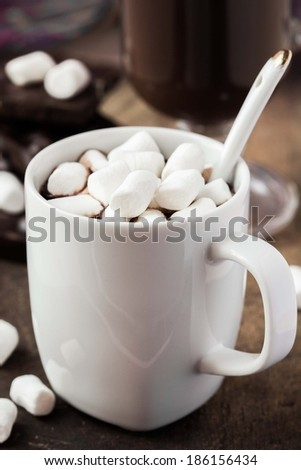 Drink hot chocolate with marshmallows in white cup - stock photo
