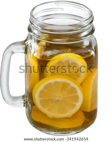 Drink in a mason jar glass with lemons