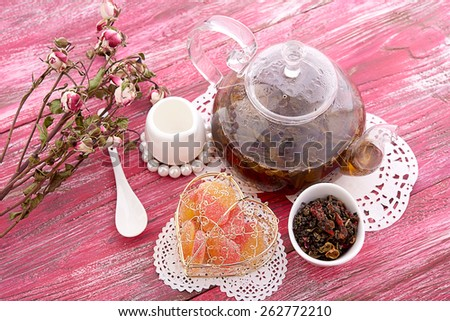 drink in glass teapot on wooden background