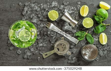 Drink making tools and ingredients for cocktail. Mojito. Caipirinha - stock photo