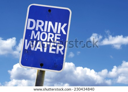 Drink More Water sign with sky on background - stock photo