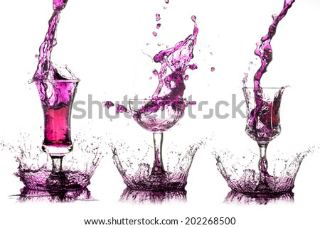 Drink plrple splash out of the glass on a white background. - stock photo