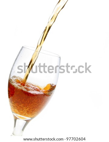 Drink pouring into a glass. - stock photo