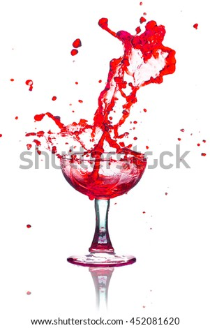 Drink red Splash out of glass on a white background. - stock photo