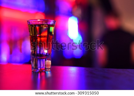 drink shot at the bar counter - stock photo