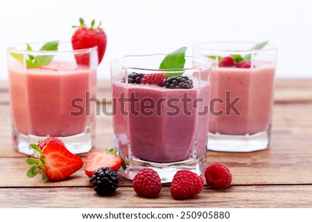 Drink smoothies summer strawberry, blackberry, raspberry on wooden table. healthy lifestyle concept. horizontally - stock photo