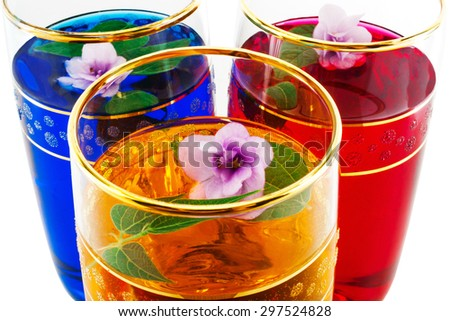 drink three colors of flowers, close-up, yellow, white background - stock photo