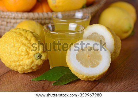 drink with citron juice with fruit around - stock photo