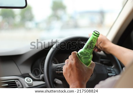 Drinking Beer or alcoho while Driving a Car