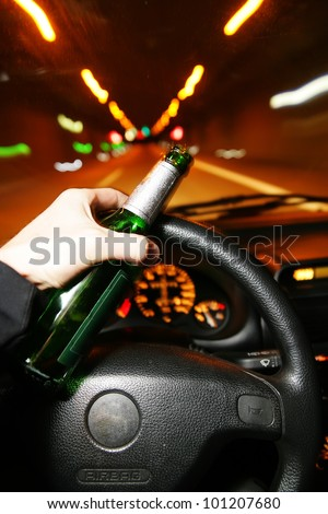 drinking beer while driving car - stock photo