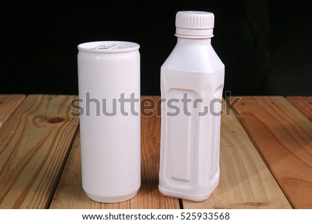 drinking bottles box-shaped and made of plastic, aluminum, with black background