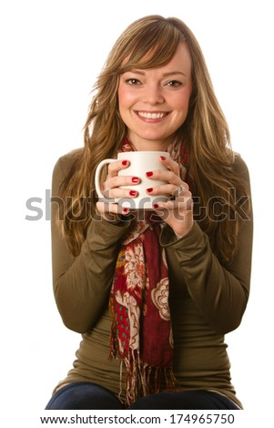 Drinking Coffee - This is a photo of a young woman smiling and enjoying a cup of coffee. Shot on a white background with a shallow depth of field. - stock photo