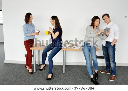 Drinking coffee while discussing business. - stock photo