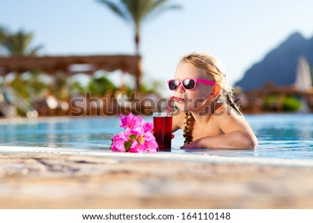 drinking girl at the pool - stock photo