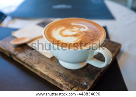Drinking object Cups of coffee on the wood table, latte art close up - stock photo