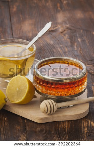 Drinking tea with honey in the village - stock photo