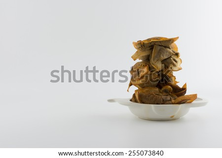 Drinking too much tea - stack of used teabags in stained tea bag holder with copy space - stock photo