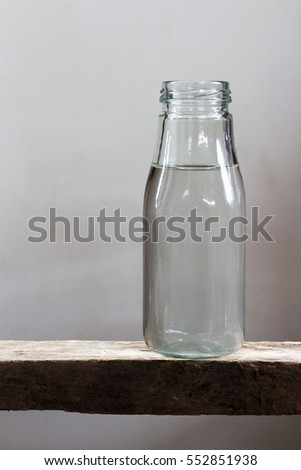 Drinking water in bottles on a wooden floor.
