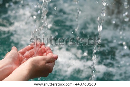 Drinking water & natural water in the hands. - stock photo