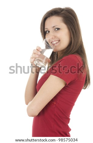 drinking water teenage girl with glass, white background - stock photo