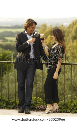Drinking wine in a terrace - stock photo