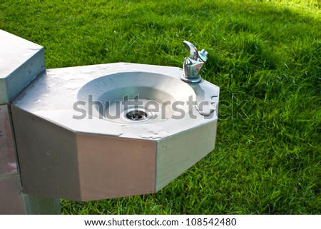 drinks from a public drinking fountain - stock photo