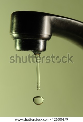 Dripping faucet - stock photo