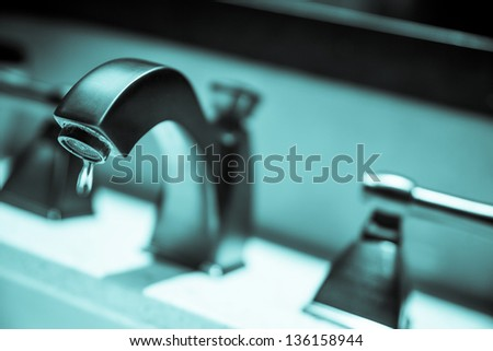 Dripping faucet. Water conservation concept - stock photo