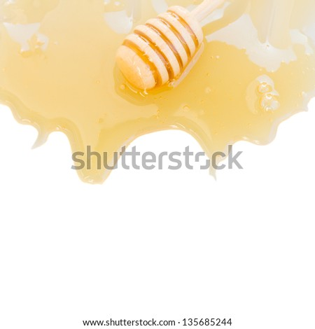 dripping honey and honey stick isolated on white background