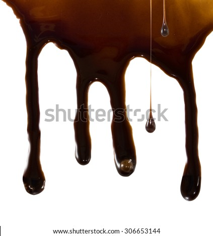 dripping liquid chocolate on a white background - stock photo
